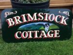 Hand painted sign for a holiday cottage